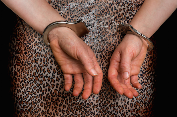 how to file a restraining order - woman in handcuffs