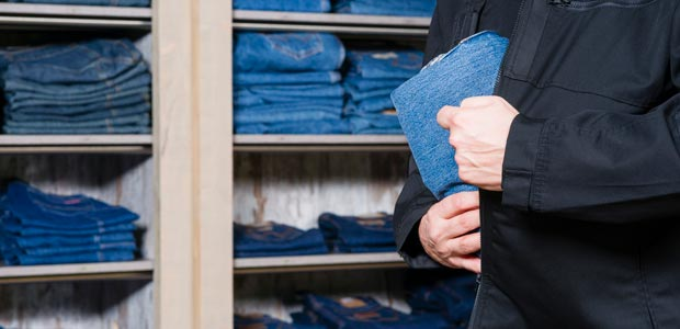 A shoplifter steals a pair of jeans