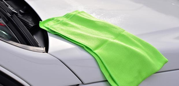 A microfiber cloth resting atop a newly detailed car