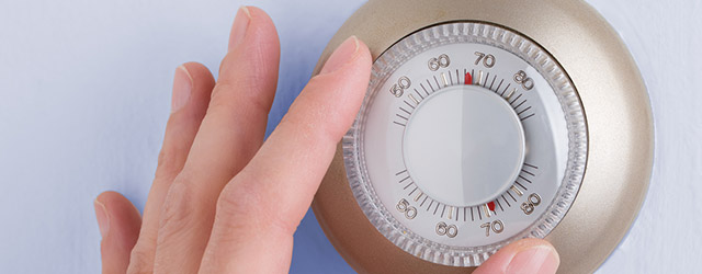Turning a knob on the thermometer