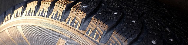 A close up of a winterized tire