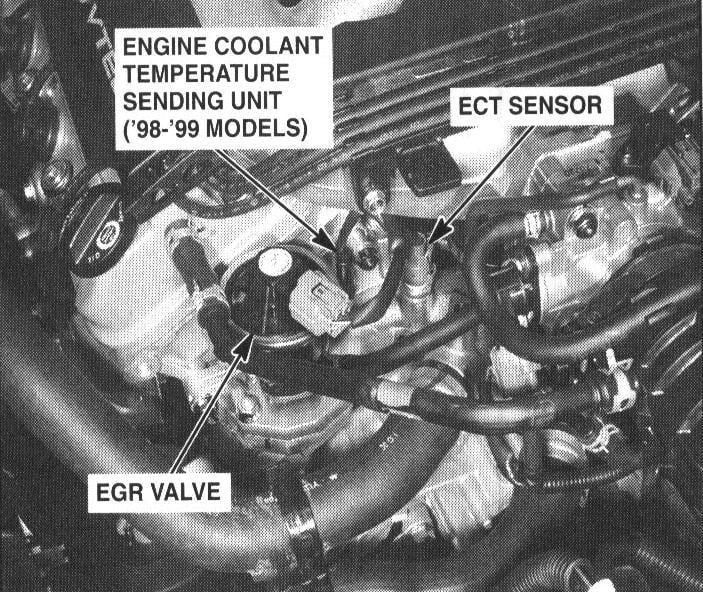 locate  engine coolant temperature sensor  disconnect  electrical connection