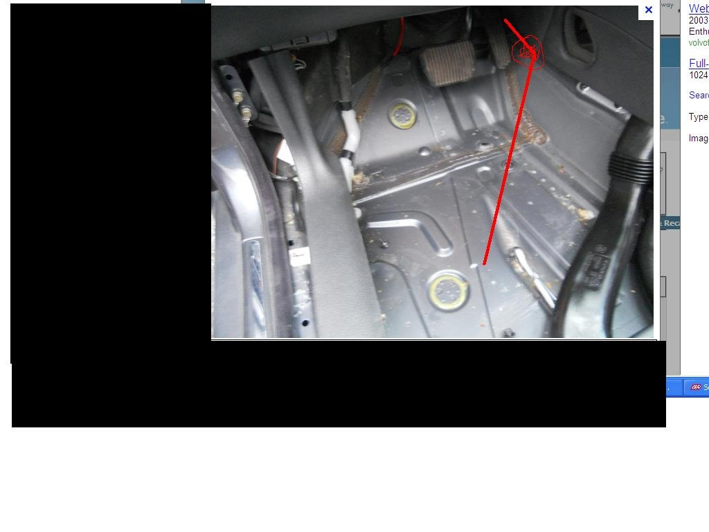 How do I unclog the AC condensation drain on a 2006 S60?