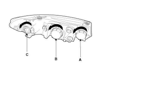 how do i change the low beam headlight bulb on my kia 2011