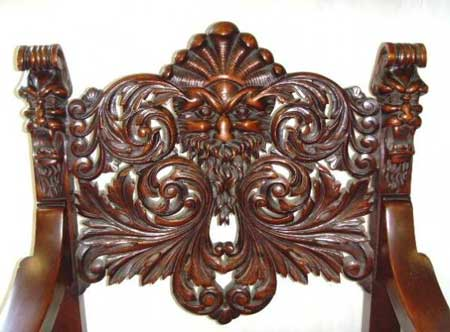 graphic - I Have A Chair With A Face Carved Accross The Back. Face Is