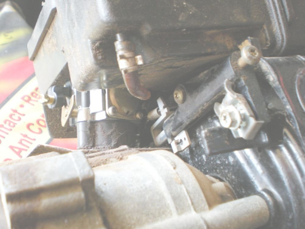 I need a diagram for the carbureter throttle spring setup