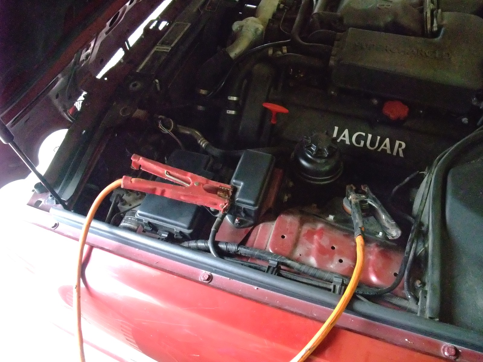 How to jump start a 1997 xjr when the trunk won't open