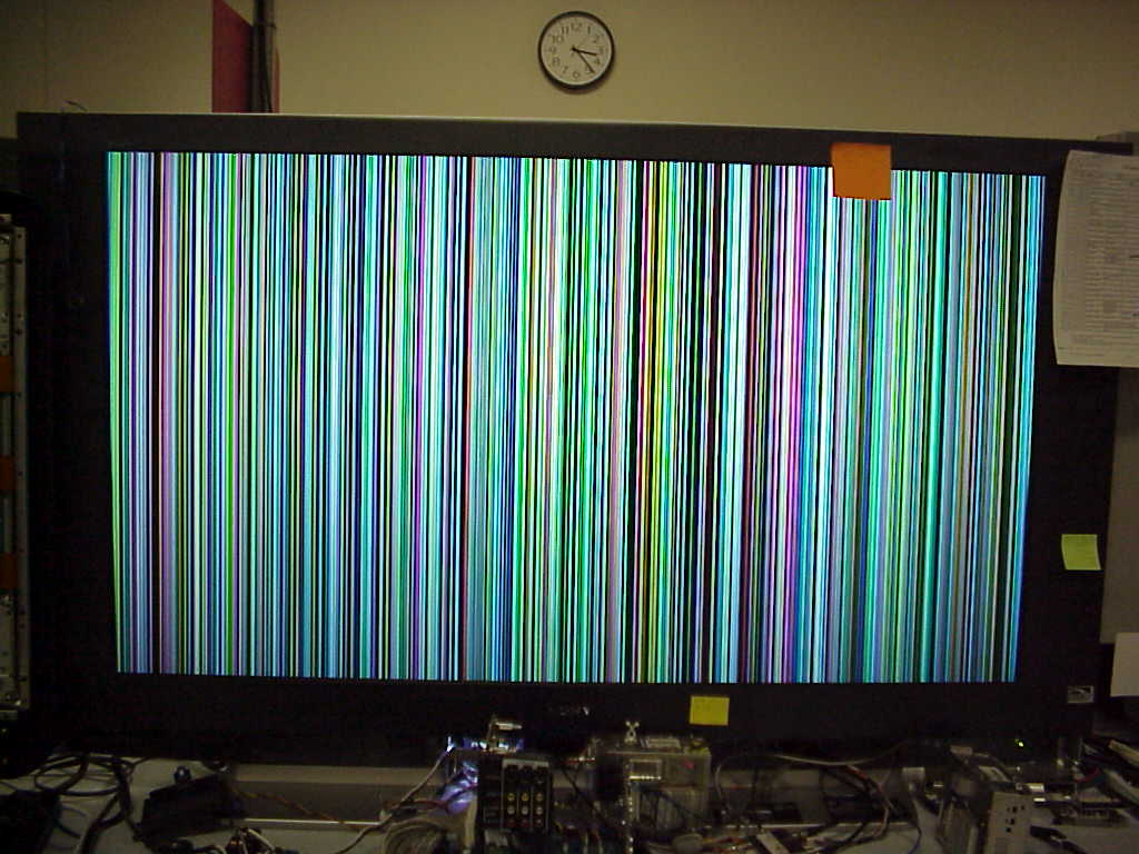 My sony tv only shows a rainbow of vertical stripes when the power